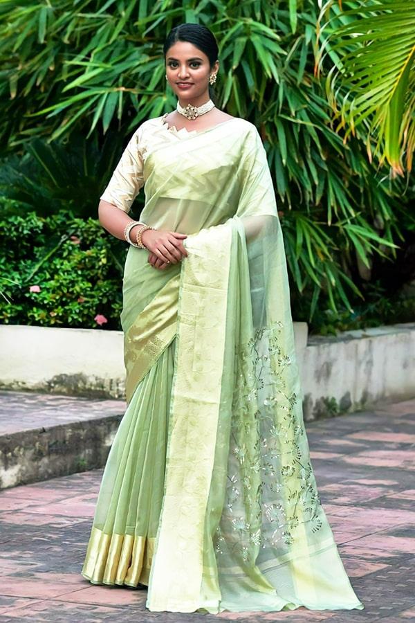 Latest Partywear new saree designs 2021 green .