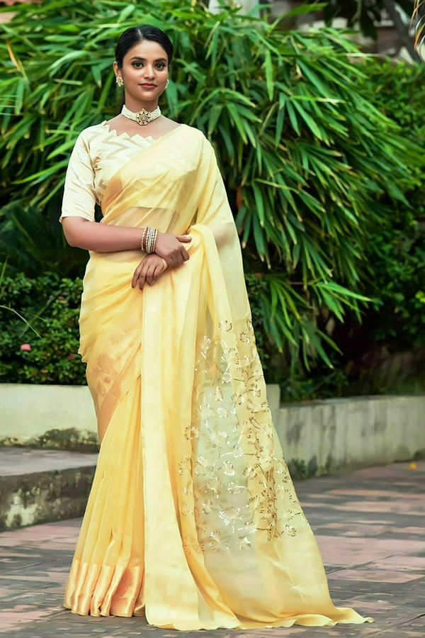 Latest Partywear new saree designs 2021 yellow