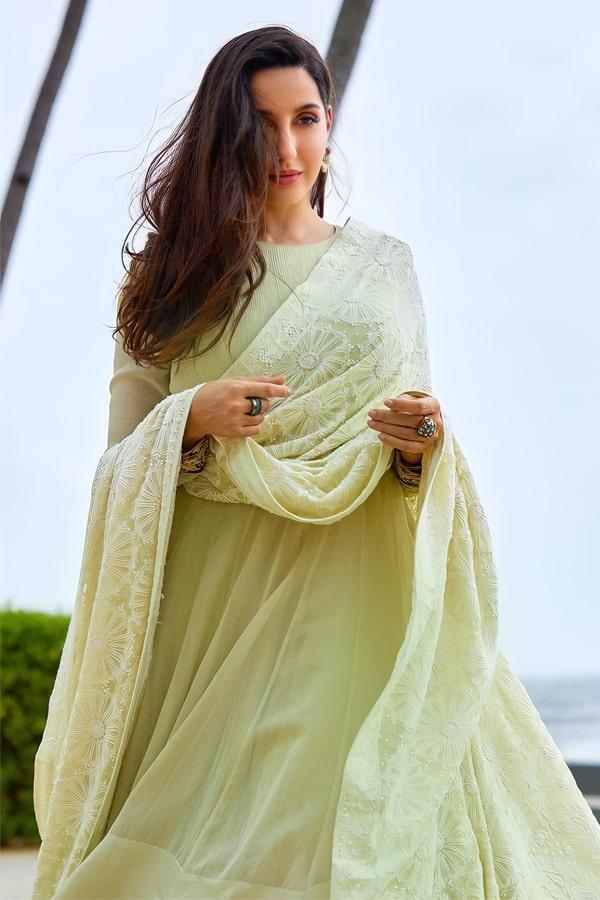 Nora fatehi dress online shopping gown.