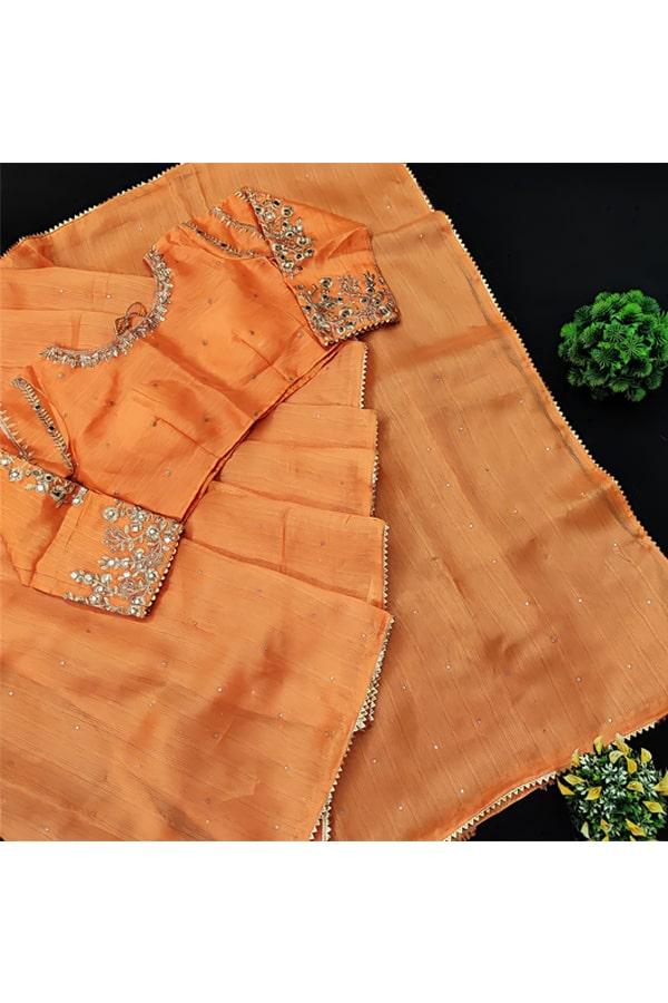 Simple Indian wedding guest look in saree