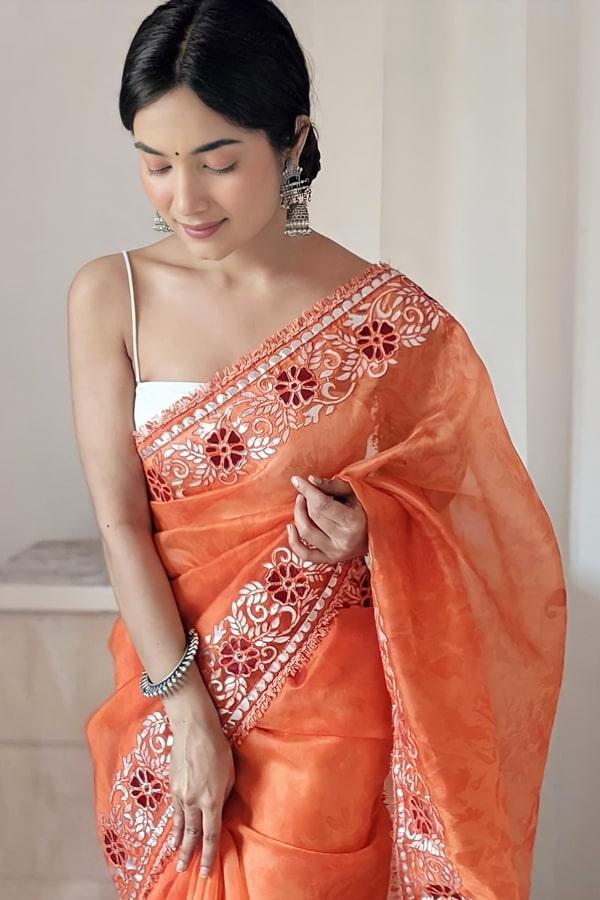 Designer sarees for wedding party online .