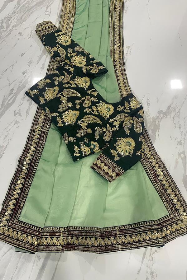 Organza saree with zari border for Ladies.