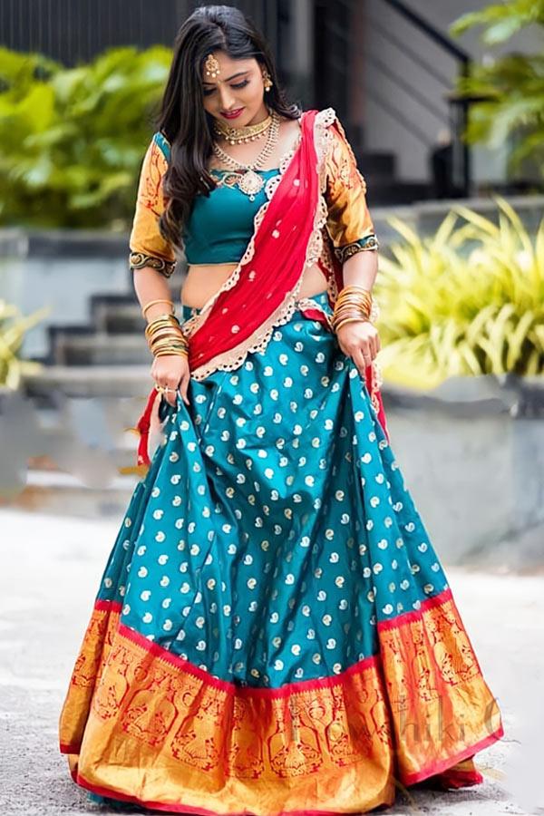 Traditional half saree designs online.